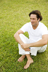 Man sitting cross legged on the grass