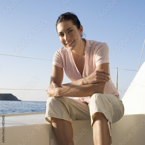 A woman sitting on the edge of a boat