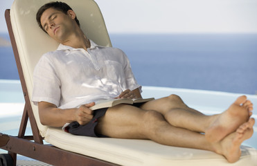 A man relaxing by a pool