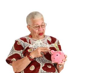 Retired woman holkding piggy bank