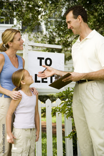Mother and daughter consulting letting agent about property to let