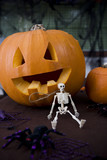 Still life of Jack'o Lantern and plastic toy skeleton for Halloween