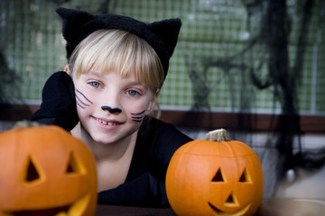 Little girl in a cat outfit dressed up for Halloween