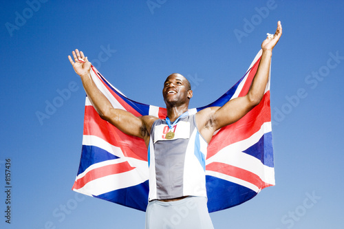 Portrait of a male athlete with UK flag