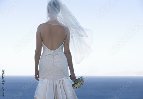 A bride looking out to sea