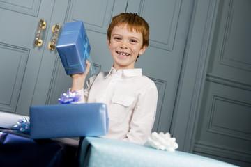 smiling boy holding present