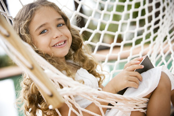 little girl sitting in a hammock