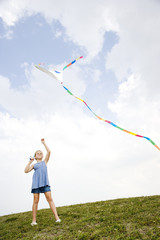 girl flying kite