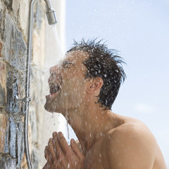 A man cooling off under a shower