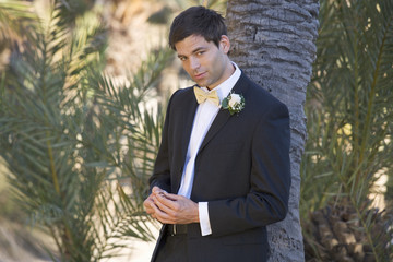 A groom looking at the wedding ring