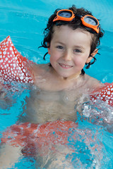 Child in the pool on holiday