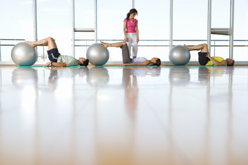 People taking exercise class with exercise balls, low angle view