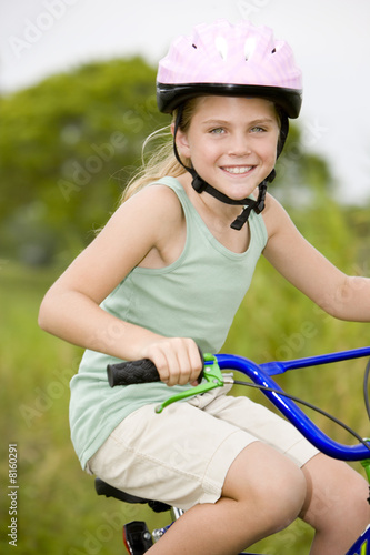 portrait girl on bicycle