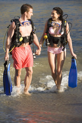 A couple returning from scuba diving