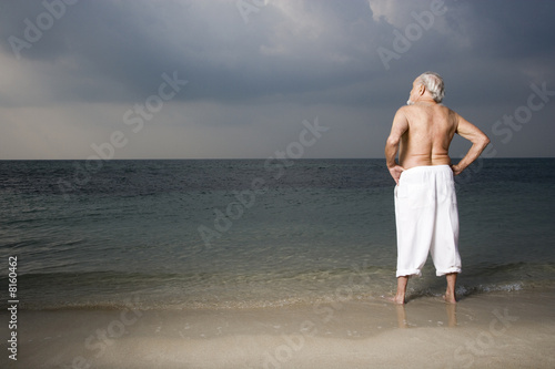 Portrait of a senior man looking out to sea