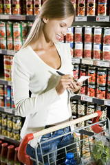 Woman ticking off her shopping list