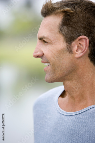 side view mid adult man in blue sweater