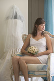 A bride sitting in a chair