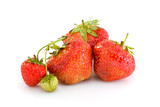 Some ripe red and one unripe strawberries poster