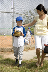 Mother encouraging son at baseball game