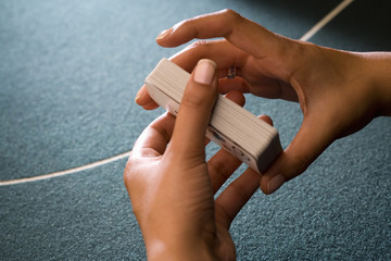 Croupier shuffling cards, close-up of hands