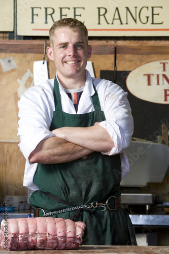 Butcher with arms crossed, smiling, portrait