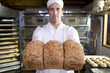 Baker with loaves of bread, portrait