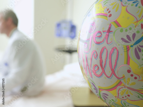 'Get Well' balloon in hospital, doctor in background