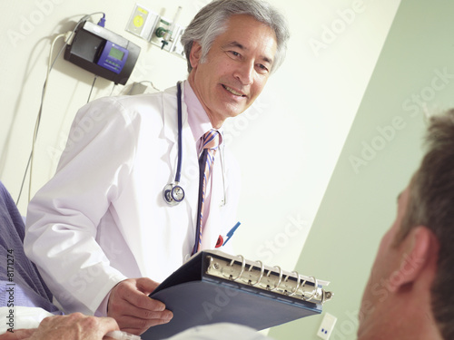 Doctor with patient, smiling (tilt)