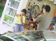 Father and son (7-9) fixing bicycle in garage
