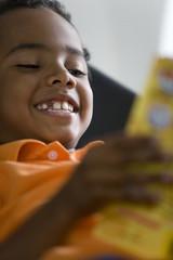 Boy (4-6) reading book