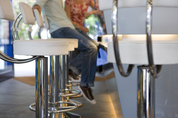 Couple on bar stools, low section