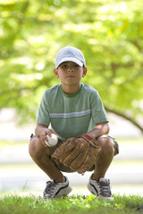 Boy (8-10) with baseball and mitt