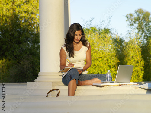 Young woman studying outdoors