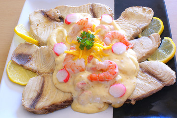 Shark fillet with seafood sauce on plate