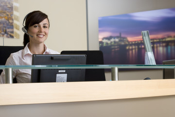 Receptionist, smiling, portrait, low angle view