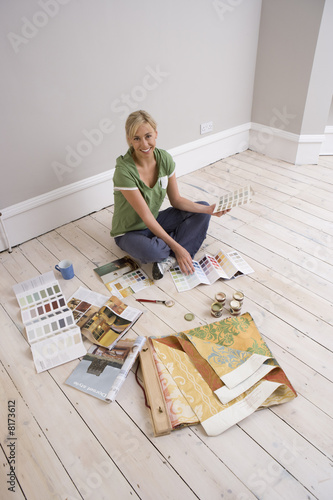 Woman with colour swatches, smiling, portrait, elevated view