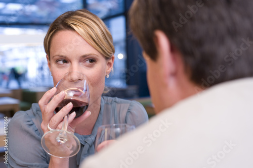 Couple drinking wine in restaurant, close-up