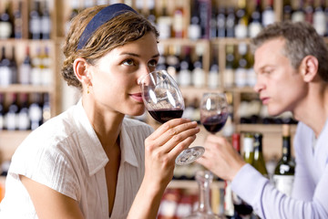 Woman and man drinking wine