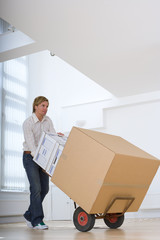Man moving boxes, low angle view