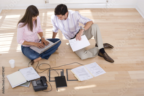 Young couple, woman with laptop computer