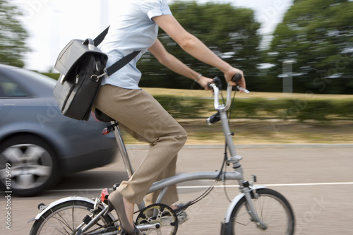 Woman on bicycle, mid section (blurred motion)