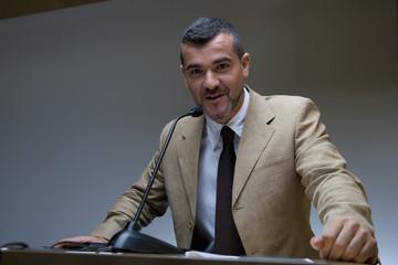 Businessman giving speech, portrait