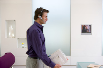 Businessman with headset in office (blurred motion)