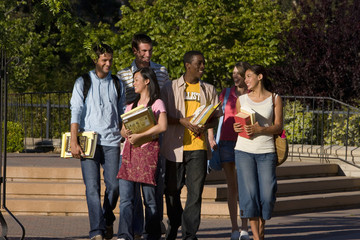 Students outdoors, smiling