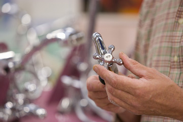 Man shopping in hardware store, close-up of hands