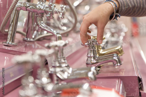 Man shopping in hardware store, close-up of hand