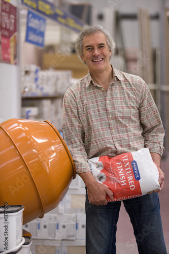 Man shopping in hardware store, portrait
