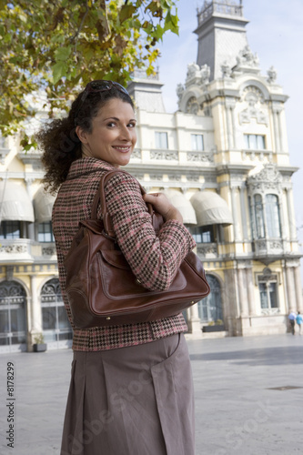 Woman standing outdoors in urban setting