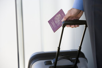 Businessman with luggage and passport